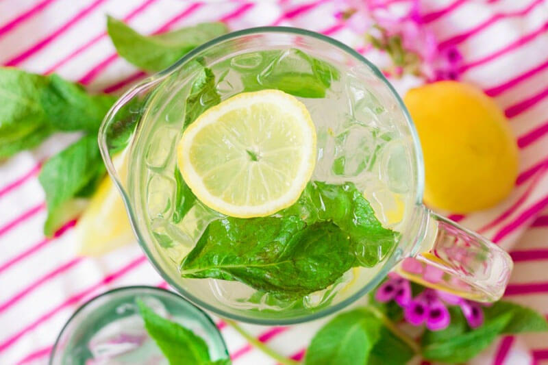 refreshing keto and trim healthy mama summer drink with lemon slices and basil leaves