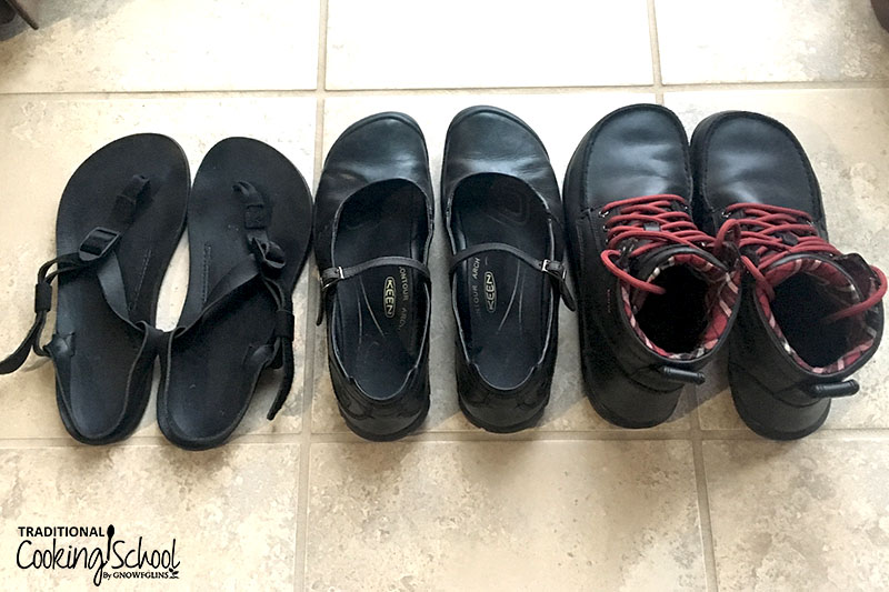 """three pairs of black """"zero shoes"""" including sandals, Mary Janes, and boots"""