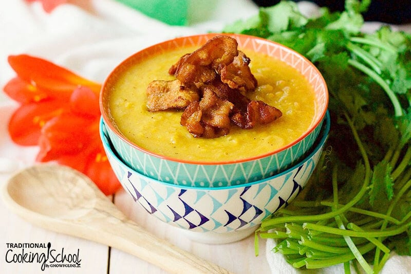 brightly patterned teal bowls full of sweet corn chowder topped with crispy bacon