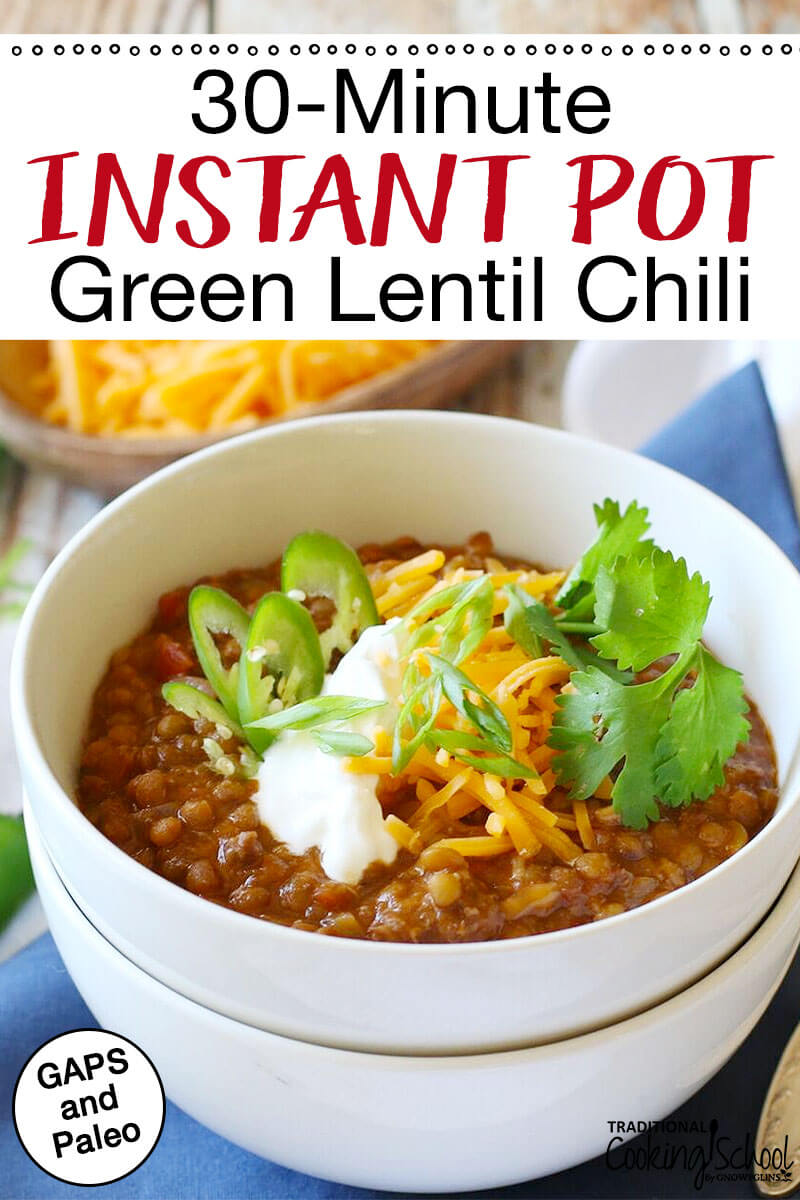 "bowl of chili topped with sour cream, shredded cheddar, peppers, and cilantro with text overlay: ""30-Minute Instant Pot Green Lentil Chili"""