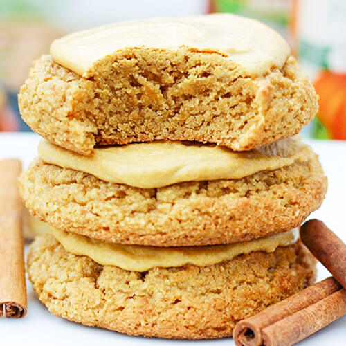 stack of three glazed sugar cookies with bite taken out of the top one