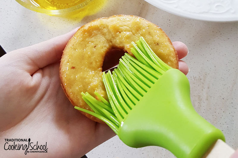 baked donut buttered with green brush
