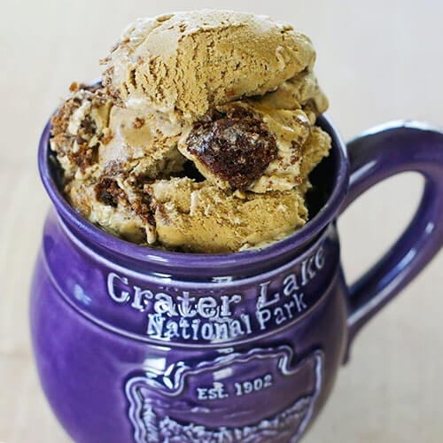 deep purple Crater Lake National Park mug full of gingerbread cookie chunk ice cream scoops