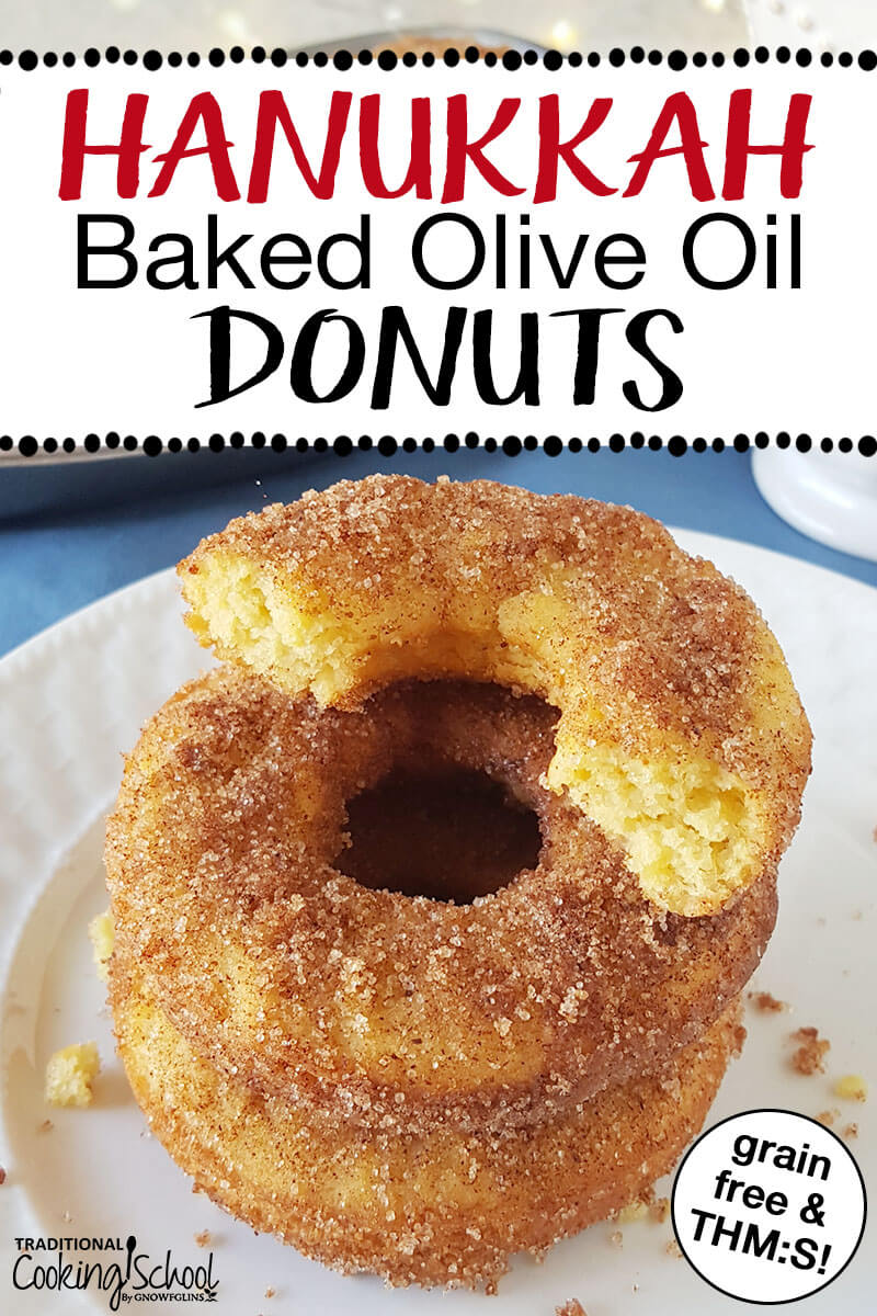 "Stack of cinnamon dusted donuts sitting on a white plate with text overlay that says, ""Hanukkah Baked Olive Oil Donuts, grain free & THM:S"""