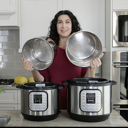 woman in a kitchen holding up the insert pots for two instant pots
