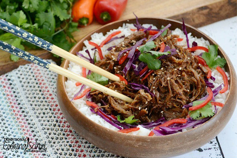 sweet and spicy asian pulled pork over a bed of white rice