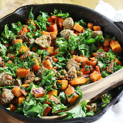 cast iron skillet full of sausage and sweet potato breakfast hash