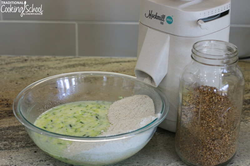 grinding flour into bowl with Mockmill