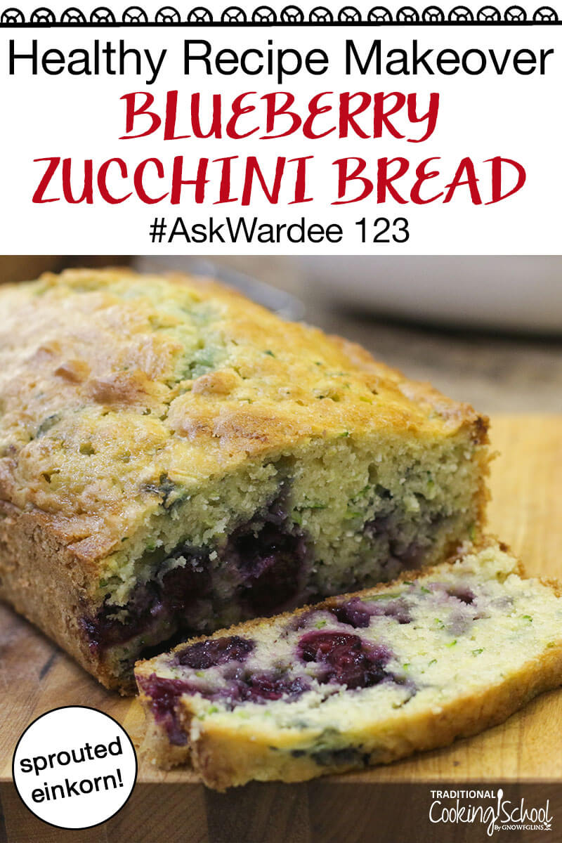 """Loaf pan with blueberry zucchini bread on a cooling rack with Mockmill grain mill and a jar of einkorn grain in the background. Text overlay says, """"Healthy Recipe Makeover Blueberry Zucchini Bread #AskWardee 123""""."""