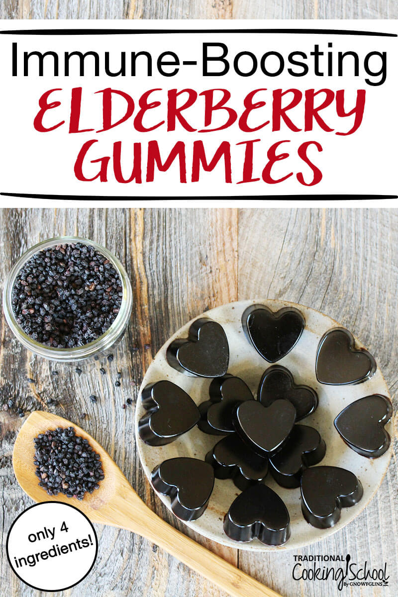 "a small jar and spoonful of elderberries on a wooden table next to a plate of heart-shaped elderberry gummies with text overlay: ""Immune-Boosting Elderberry Gummies"""