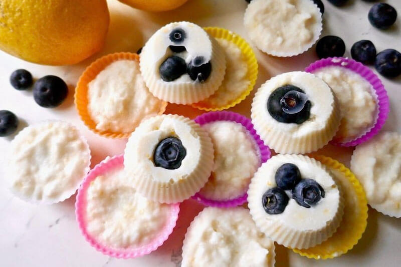 lemon blueberry fat bombs in tiny colorful silicone muffin cups