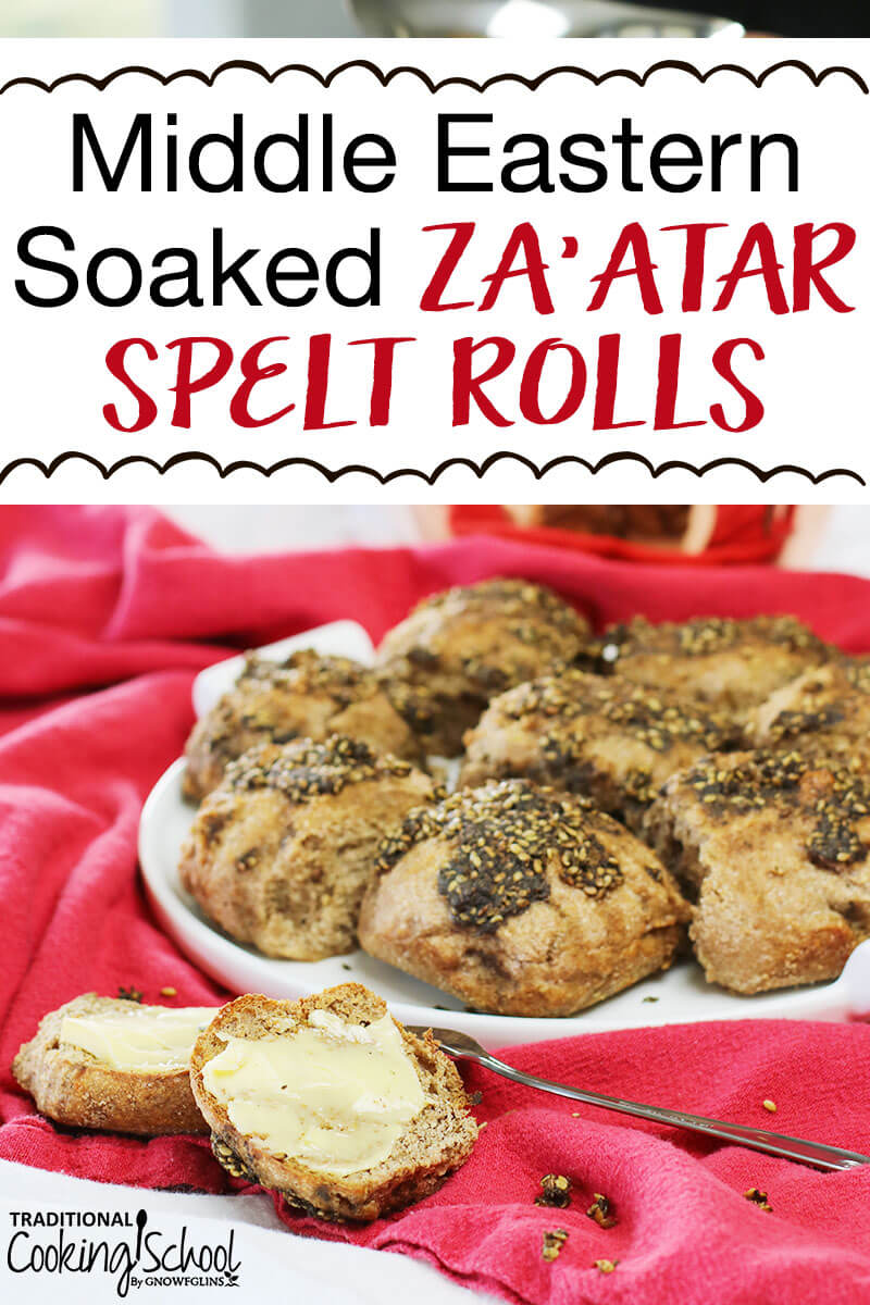 "plate of soaked spelt rolls brushed with za'atar spice blend, and in the foreground a toasted roll sliced open and buttered, with text overlay: ""Middle Eastern Soaked Za'atar Spelt Rolls"""