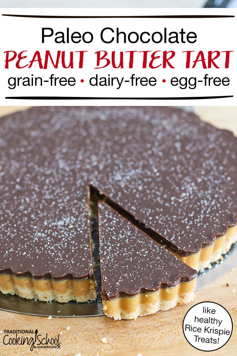 """beautiful chocolate peanut butter tart sprinkled with sea salt, with a wedge slightly separated from the rest, and text overlay: """"Paleo Peanut Butter Tart like healthy Rice Krispie Treats! (grain-free, dairy-free, egg-free)"""""""
