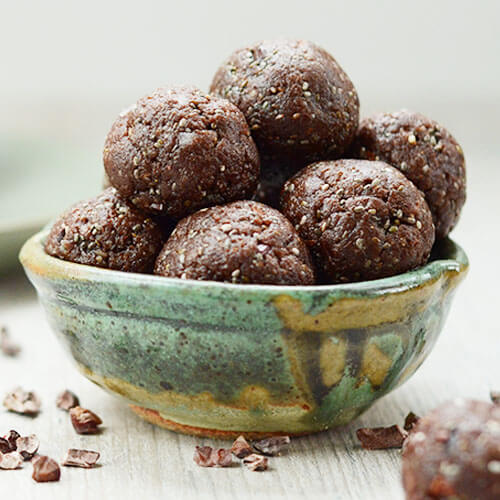 green-blue ceramic bowl of no bake energy balls