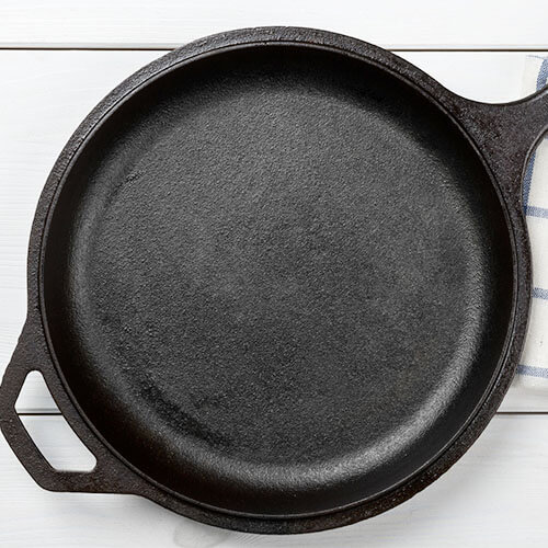 well-seasoned cast iron skillet on a white background