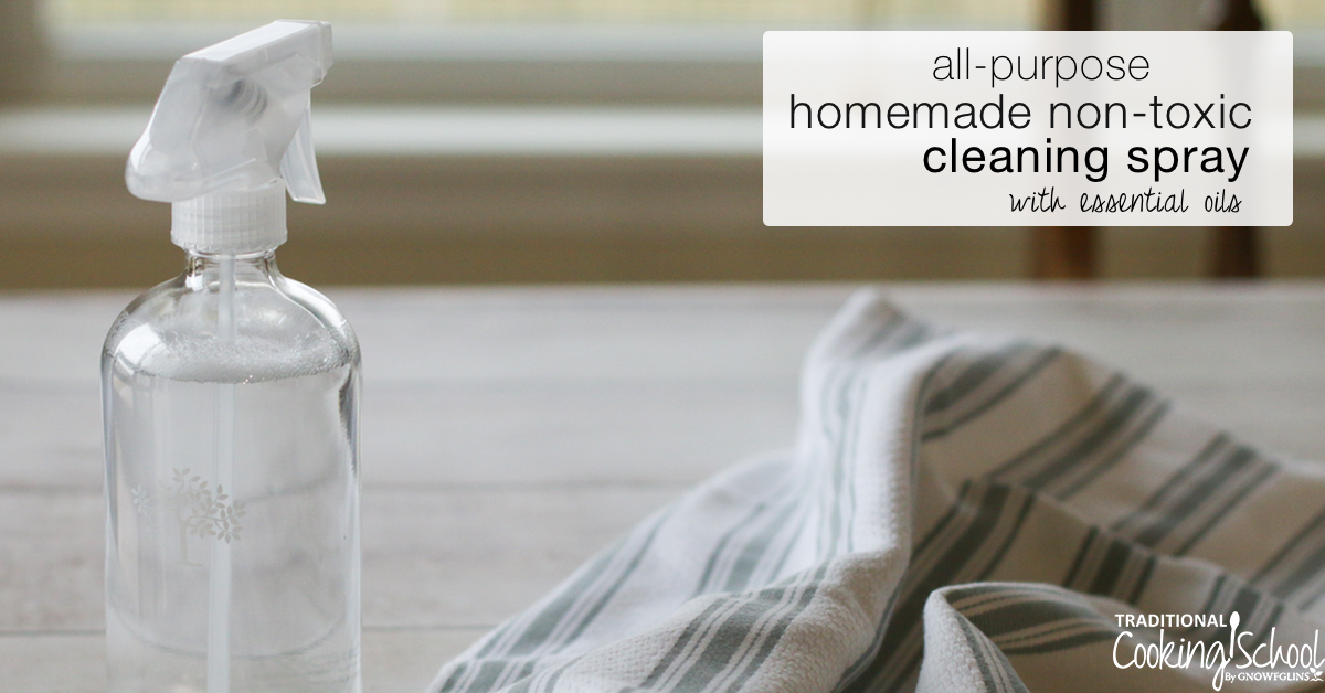"clear glass spray bottle with a white plastic head filled with a nontoxic cleaning solution, next to a gray and white striped towel, with text overlay: ""all-purpose homemade non-toxic cleaning spray with essential oils"""