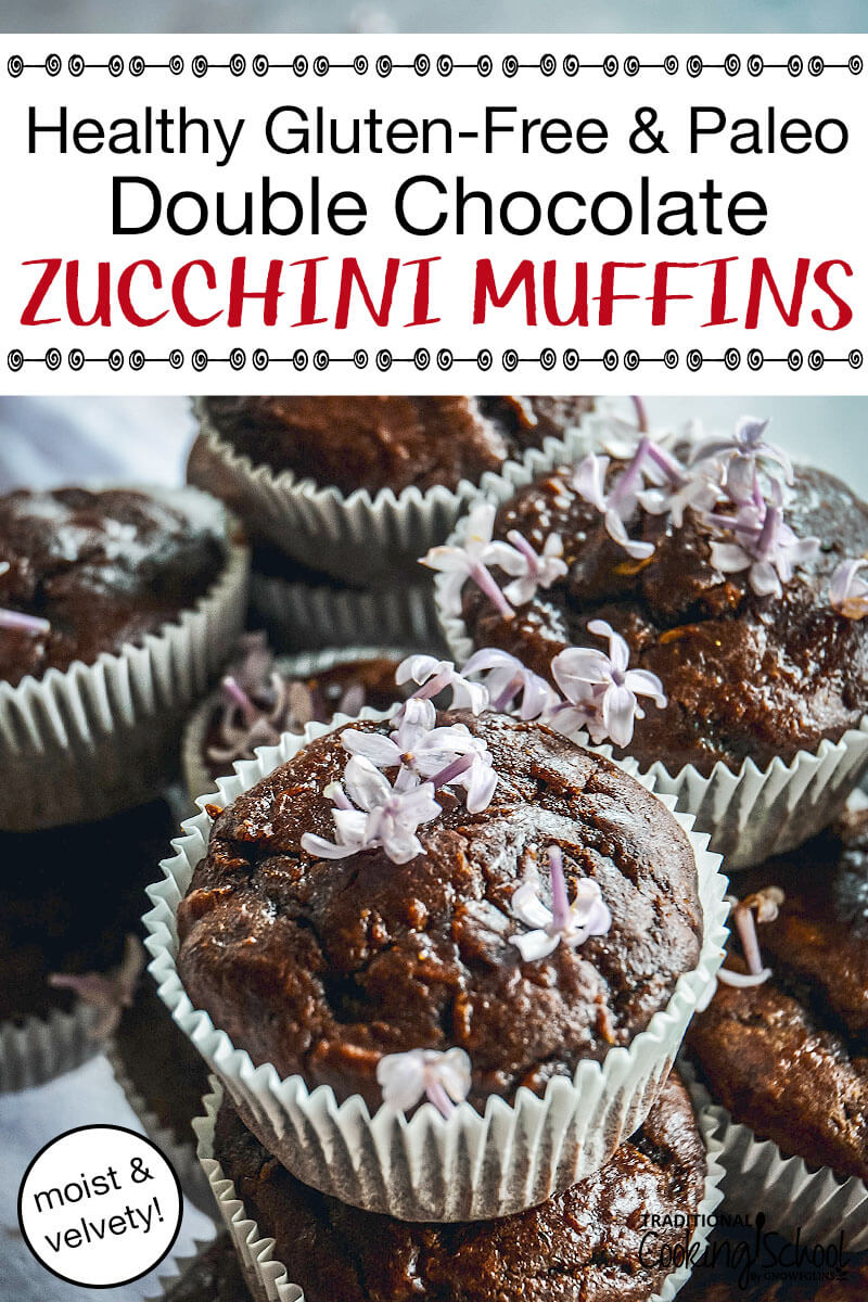 "an asymmetrical stack of gooey and moist-looking chocolate muffins in pale blue muffin cups, sprinkled with light purple flowers on top and text overlay: ""Healthy Gluten-Free & Paleo Double Chocolate Zucchini Muffins (moist & velvety!)"""
