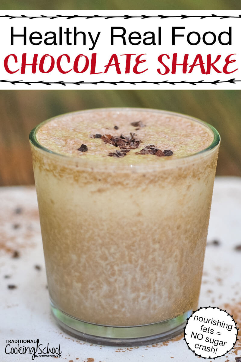 "small cup filled to the brim with a homemade chocolate milkshake, garnished with a pinch of cacao nibs, with text overlay: ""Healthy Real Food Chocolate Shake (nourishing fats = NO sugar crash!)"""