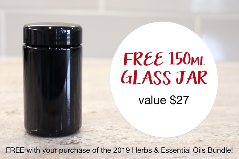 "small black opaque jar on a counter top with text overlay: ""FREE 150mL Glass Jar, value $27, FREE with your purchase of the 2019 Herbs & Essential Oils Bundle"""