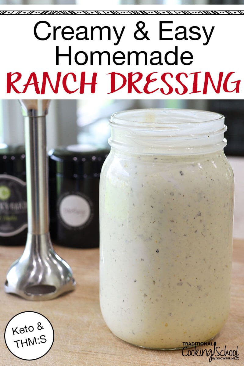 "quart-sized Mason jar of creamy healthy ranch dressing with stick blender and jars of herbs in the background, with text overlay: ""Creamy & Easy Homemade Ranch Dressing (Keto & THM:S)"