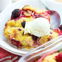 Looking for the best dessert recipes? You're in luck! This Mixed Berry Bread Pudding calls for airy bread, creamy custard, coconut sugar, and your favorite fresh or frozen berries. Serve warm or cold for breakfast, or with vanilla ice cream or caramel sauce for an easy, amazing treat! Bonus: I've included seasonal variations so you can make this bread pudding recipe year round! #recipe #dessert #bread #breadpudding #oldfashioned