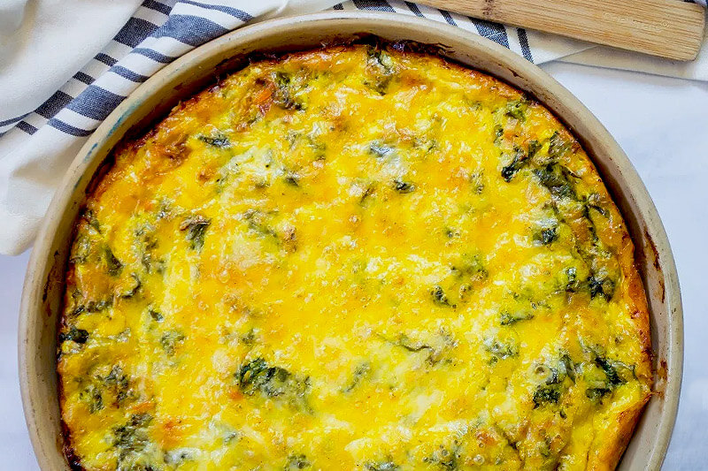 crustless kale cheddar quiche, with a golden brown crispy top