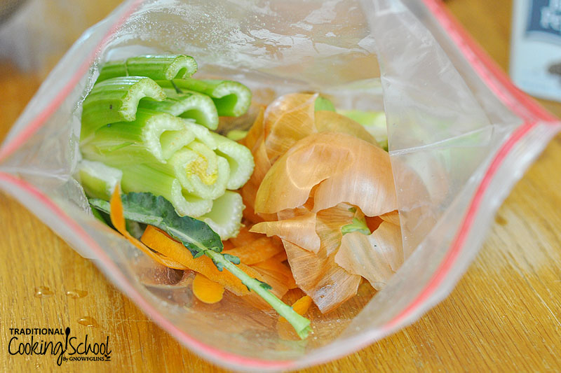 veggie scraps that have been frozen in a plastic bag in the freezer until needed
