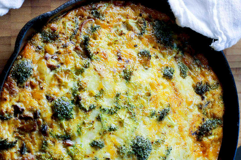 sausage and vegetable frittata in a cast iron skillet
