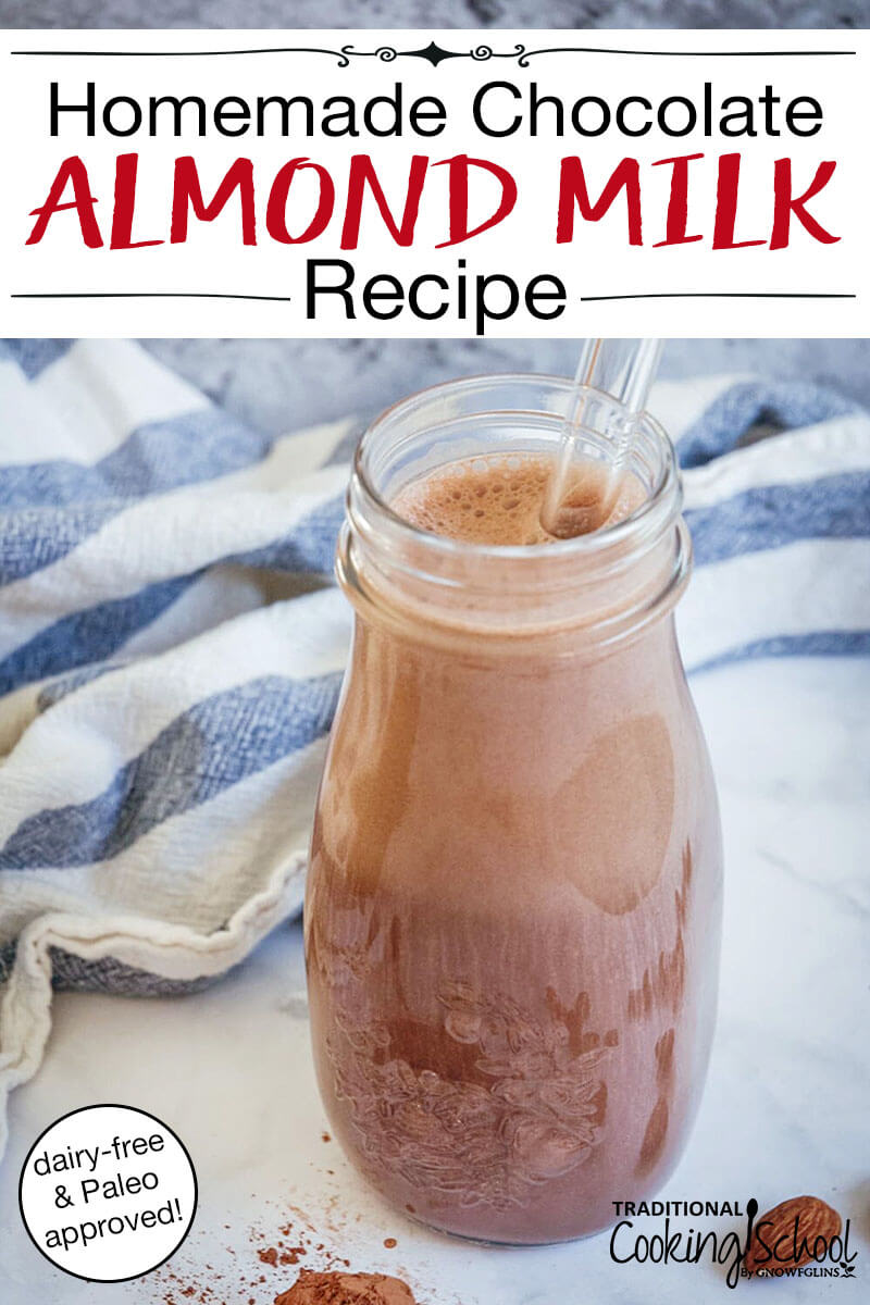 """glass bottle of foamy chocolate milk on a white stone countertop with a blue and white striped tea towel in the background, with text overlay: """"Homemade Chocolate Almond Milk Recipe (dairy-free & Paleo approved!)"""""""