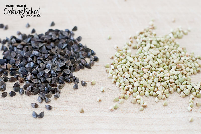 from left to right: black buckwheat groats and light green hulled buckwheat on a wooden surface