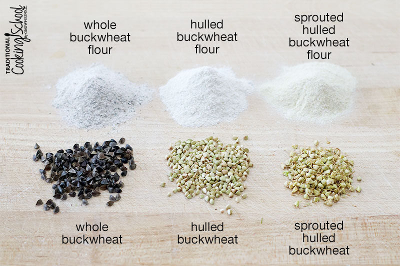 array of buckwheat on a wooden surface, from left to right: whole buckwheat flour, hulled buckwheat flour, sprouted hulled buckwheat flour, whole buckwheat, hulled buckwheat, sprouted hulled buckwheat