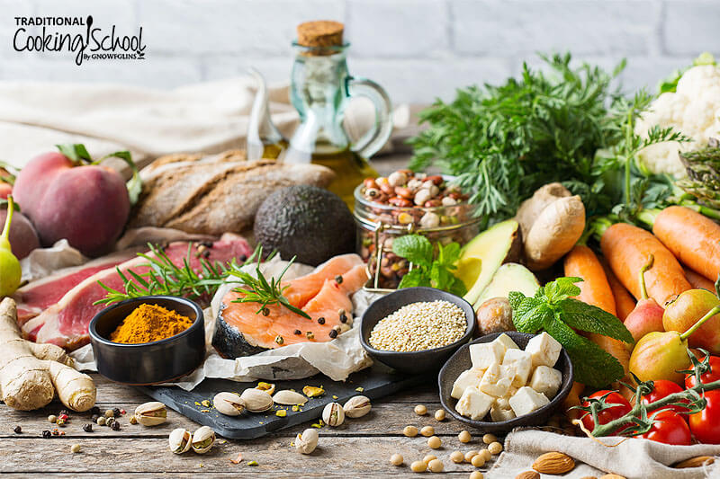 array of healthy foods, including fresh vegetables, ginger root, salmon, and more