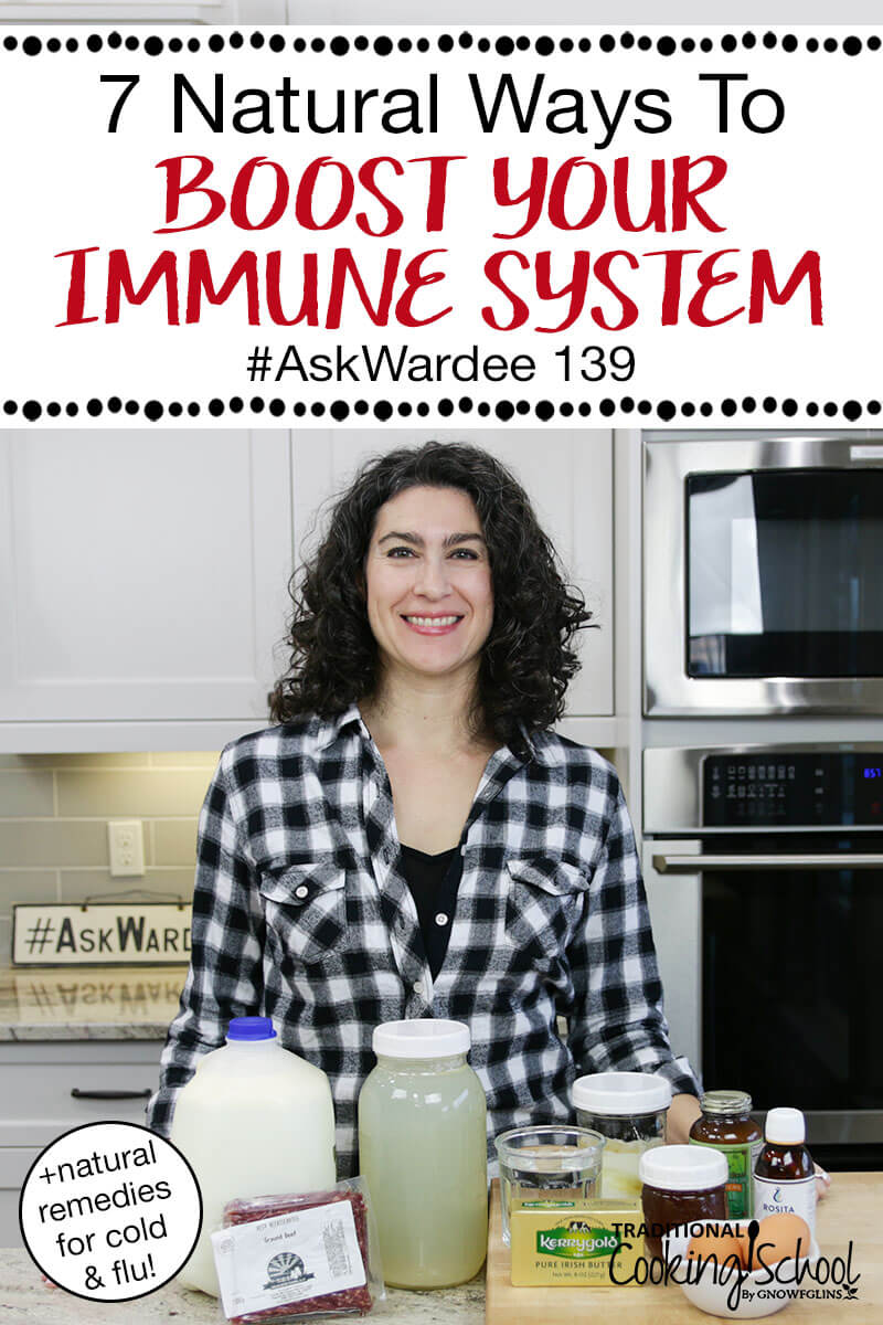 "woman smiling in a kitchen with an array of healthy ingredients in front of her, with text overlay: ""7 Natural Ways To Boost Your Immune Syste #AskWardee 139 (+natural remedies for cold & flu!)"""