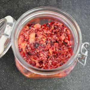 overhead shot of a glass jar of fermented cranberry relish