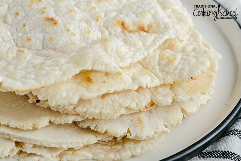 close-up of homemade cassava flour tortillas, lightly toasted with golden brown spots