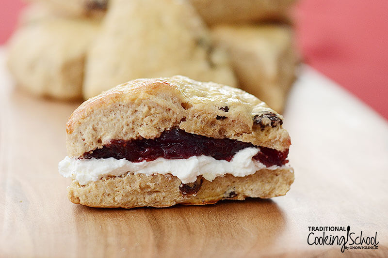 traditional English scone wedge, spread with cream and jam in the middle
