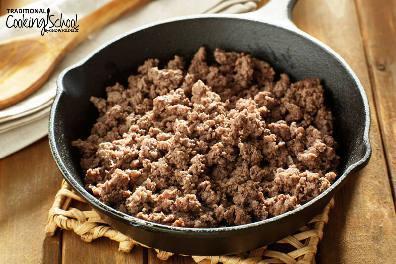 cast iron skillet of cooked ground beef