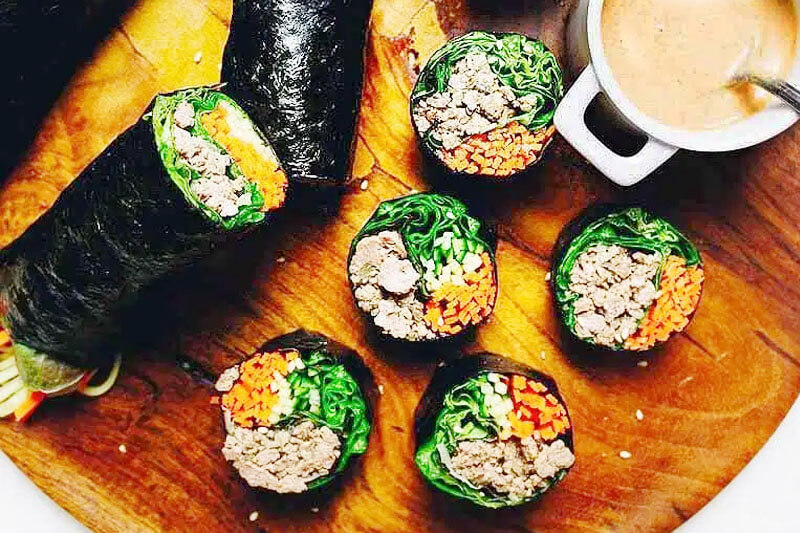 bulgogi beef sushi rolls on a wooden platter