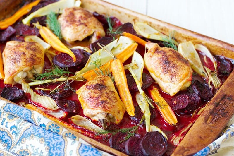 roasted beets, carrots, and chicken on a sheet pan