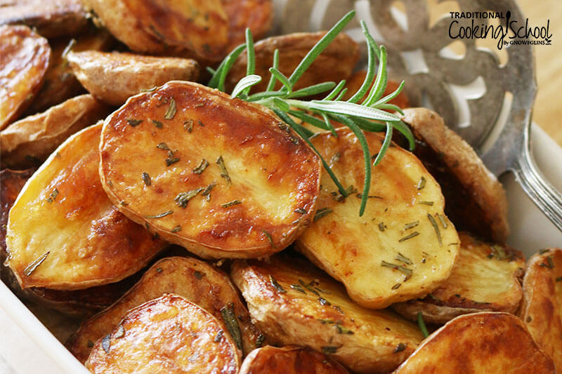 golden-brown baby potatoes sprinkled with fresh rosemary