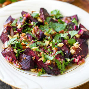 colorful beet salad sprinkled with fresh herbs