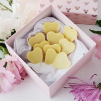 pink decorative box of cream-colored, heart-shaped homemade candy