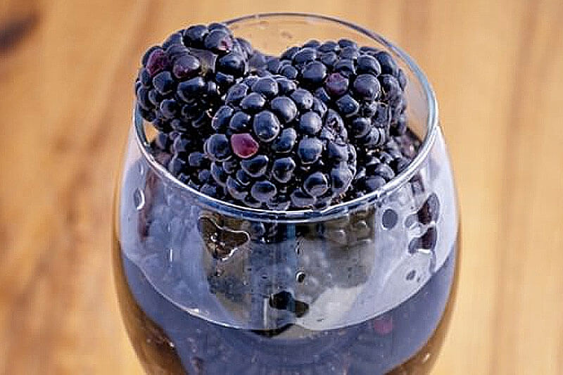 cup of blackberries for making homemade blackberry wine