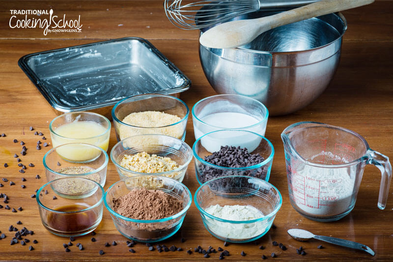 Brownie ingredients in clear glass bowls.