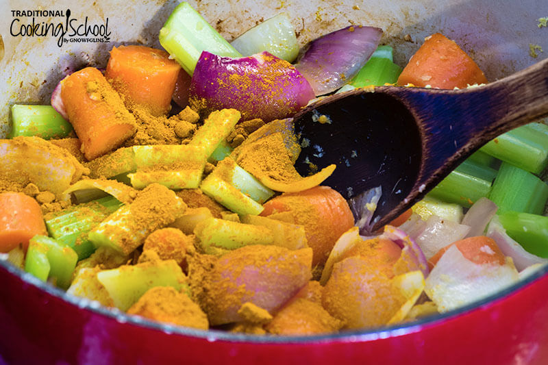 Large stock pot filled with carrots, celery, onions and spices for chicken stew.