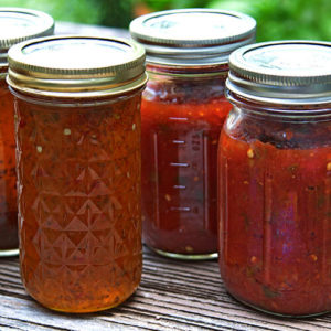 Mason jars of canned tomatoes
