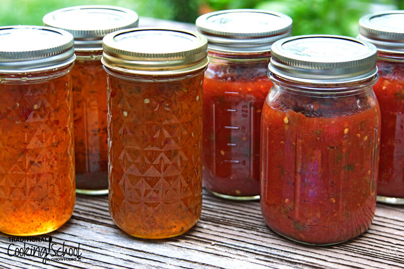 canned tomatoes in an array of Mason jars