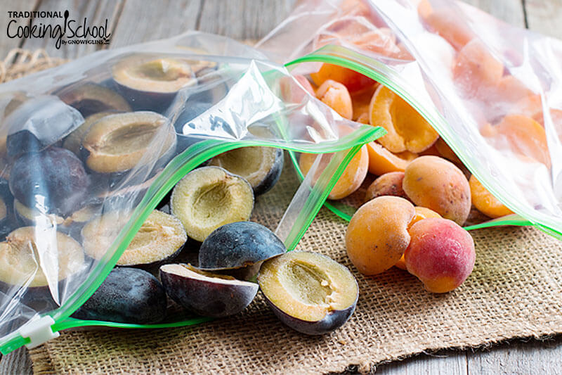 freezer bags of halved plums and apricots