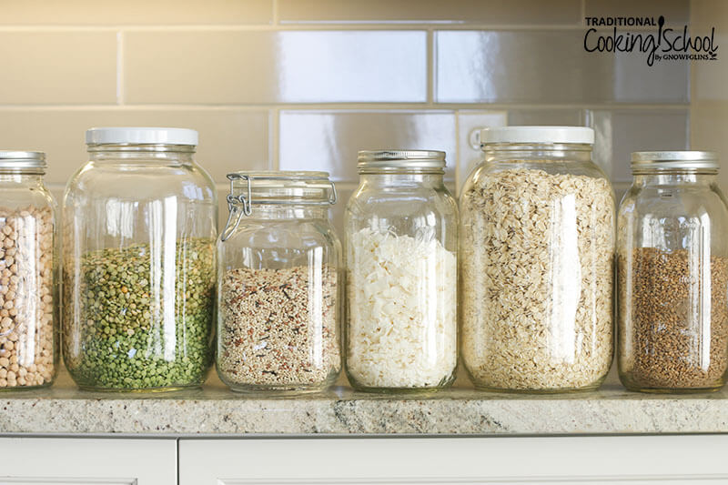 glass jars of pantry staples (grains, beans, etc.) arranged on a countertop