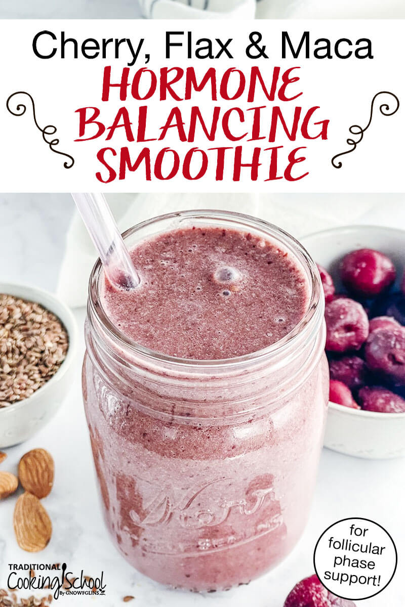 "beautiful pink smoothie in a small glass jar with a glass straw, with frozen cherries, almonds, and flax seeds in the background and text overlay: ""Cherry, Flax & Maca Hormone Balancing Smoothie (for follicular phase support!)"""